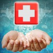 First Aid icon on hand ,medical background — Stock Photo