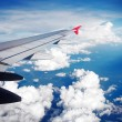 Wing of the plane on sky background — Stock Photo