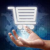 Símbolo del carrito de compras en mano, fondo de negocios — Foto de Stock