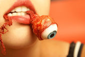 Eating an Eyeball — Stock Photo
