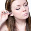 Woman using cotton bud — Stock Photo