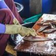 Fisherman Cutting Up And Cleaning The Fish — Stock Photo
