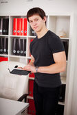 Young guy using diary — Stock Photo
