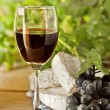 Red wine, grape, Brie and Camembert cheeses — Stock Photo #19515945
