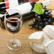Red wine, grape, Brie and Camembert cheeses — Stock Photo #19515993