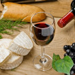 Red wine, grape, bread, Brie and Camembert cheeses — Stock Photo #19516011