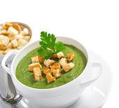 Cream soup with dried crusts — Stock Photo