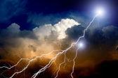 Lightnings in sunset sky — Stock Photo