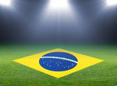 Green soccer field, brazil flag — Stock Photo