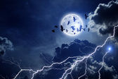 Stormy sky, flock of ravens — Stock Photo