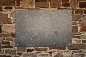 Painel de pedra na parede — Fotografia Stock