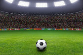 Soccer ball, stadium, light — Stock Photo