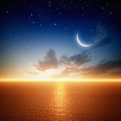Beautiful sunset with moon — Stock Photo