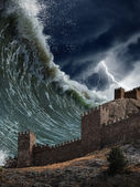 Giant tsunami waves crashing old fortress — Stock Photo