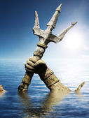 Statue of Neptune or Poseidon's arm holding trident coming up through the water — Stock Photo