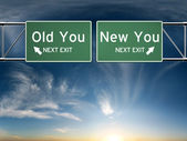 New you, old you. Sign's depicting a choice in your life — Stock Photo