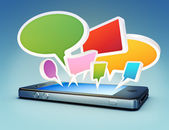 Smartphone with social media chat bubbles or speech bubbles extruding from the screen. — Stock Photo