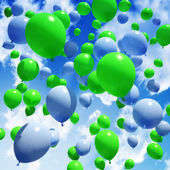 Blue and green Balloon's released into the sky — Stock Photo