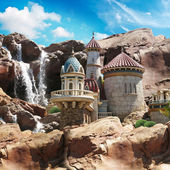 Fantasy Castle on the cliffs with a waterfall background. — Stock Photo