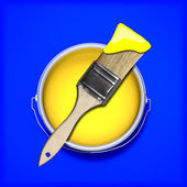 Yellow paint with wet paint brush over a contrasting colored blue background. — Stock Photo