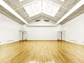 Commercial interior with hard wood floors and skylights — Stock Photo