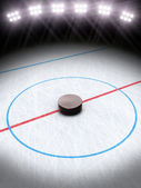 Ice hockey under the lights. Room for text or copy space. — Stock Photo