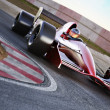 Race car racing on a track with motion blur. — Stock Photo #50674445