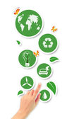 Hand pointing green ecological icons — Stock Photo
