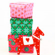 Horse toy with gift boxes isolated on white — Stock Photo