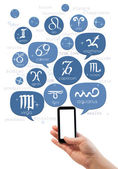 Hand holding smartphone with online astrology site template — Stock Photo