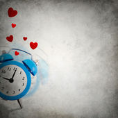 Vignette background with love ringing clock playing hide and seek — Stock Photo