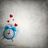 Vignette grungy background with love ringing clock and hearts — Stock Photo