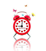 Alarm clock with butterflies and hearts instead of numbers — Stock Photo
