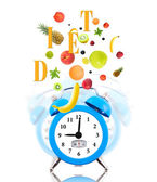 Diet concept with clock, scale dial and fresh fruits — Стоковое фото