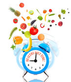 Diet concept, alarm clock ringing and fruits with vegetables. — Foto de Stock