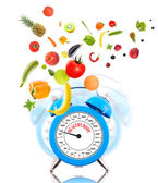 Diet concept with clock, scale dial, fruits and vegetables. — Стоковое фото
