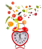 Clock in shape of heart with fruits and vegetables. — Foto de Stock