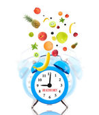 Diet concept, alarm clock ringing and fruits — Stock Photo