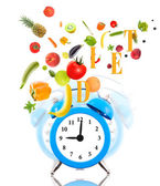 Diet concept with clock ringing, fruits and vegetables. — Stock Photo