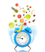Diet concept with clock, scale dial and fruits — Stock Photo