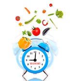 Diet concept, alarm clock ringing and vegetables. — ストック写真