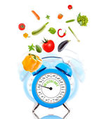 Diet concept with clock, scale dial and vegetables. — Stock Photo