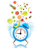 Diet concept with clock, scale dial and fruits — Стоковое фото