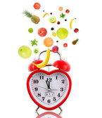 Clock in shape of heart with fruits — Stock Photo