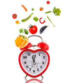 Clock in shape of heart with vegetables. — Stockfoto