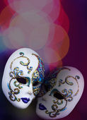 Two beautiful masks on colorful background with bokeh — Foto de Stock