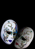 Two decorated mask isolated on black background. — Foto Stock