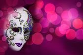Beautiful mask on festive colorful background with bokeh — Stock Photo