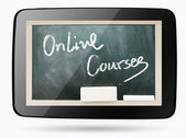 Blackboard inside computer tablet with Online Courses chalk text — Stock Photo