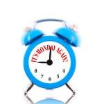 It's Monday again! Alarm clock ringing isolated on white — Stock Photo #43418937